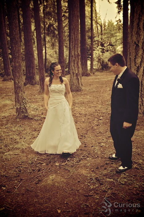 bride and groom meet in forest. processed color, antique, anticipation