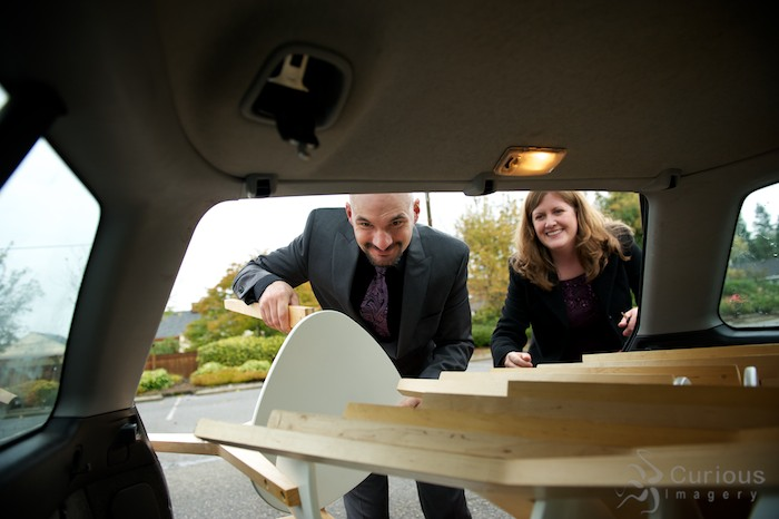 Loading chairs into back of car, packing up wedding. Evergreen Arboretum and Gardens, Everett, Washington