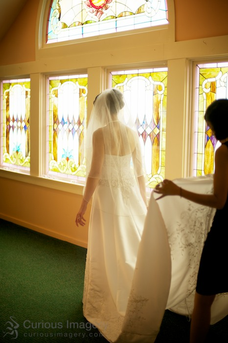 Full length bride by stained glass windows