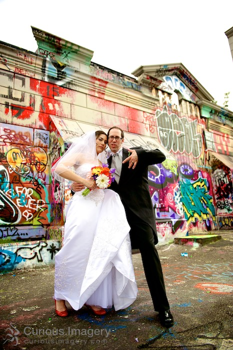Bride and groom by graffiti