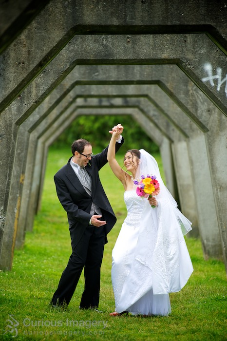 Bride and groom dancing under arches at Gasworks Park in Seattle