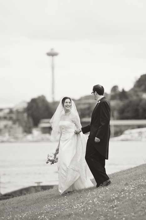 Bride and groom at Gasworks Park in front of Space Needle, Seattle