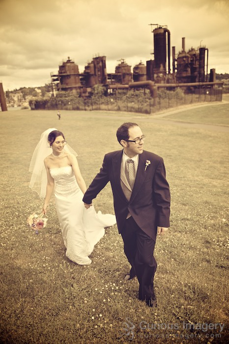 Bride and groom walking up hill at Gasworks Park